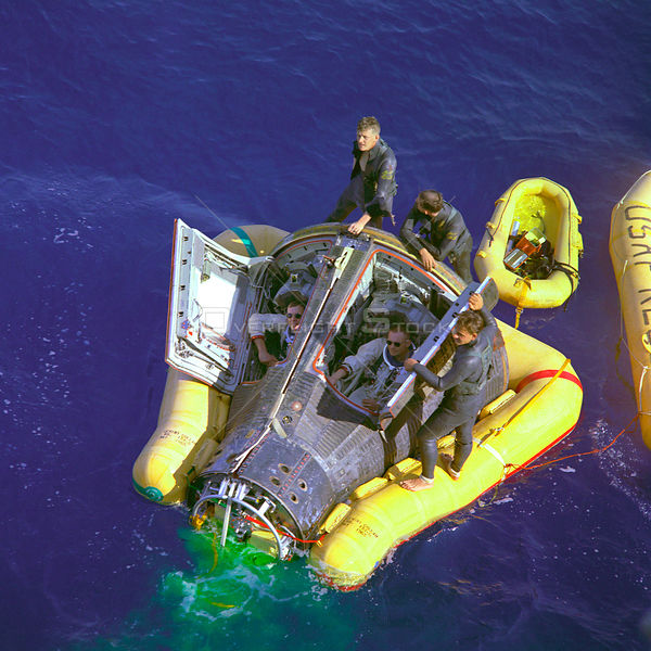 PACIFIC OCEAN -- 16 Mar 1966 -- Astronauts Neil A Armstrong and David R Scott sit with their spacecraft hatches open while aw...