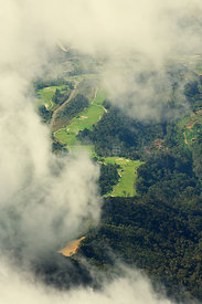 View of Mt Kinabalu Golf Club viewed through clouds from the summit, Mt Kinabalu, Sabah, Borneo.