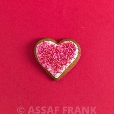 Heart shaped biscuits on red background