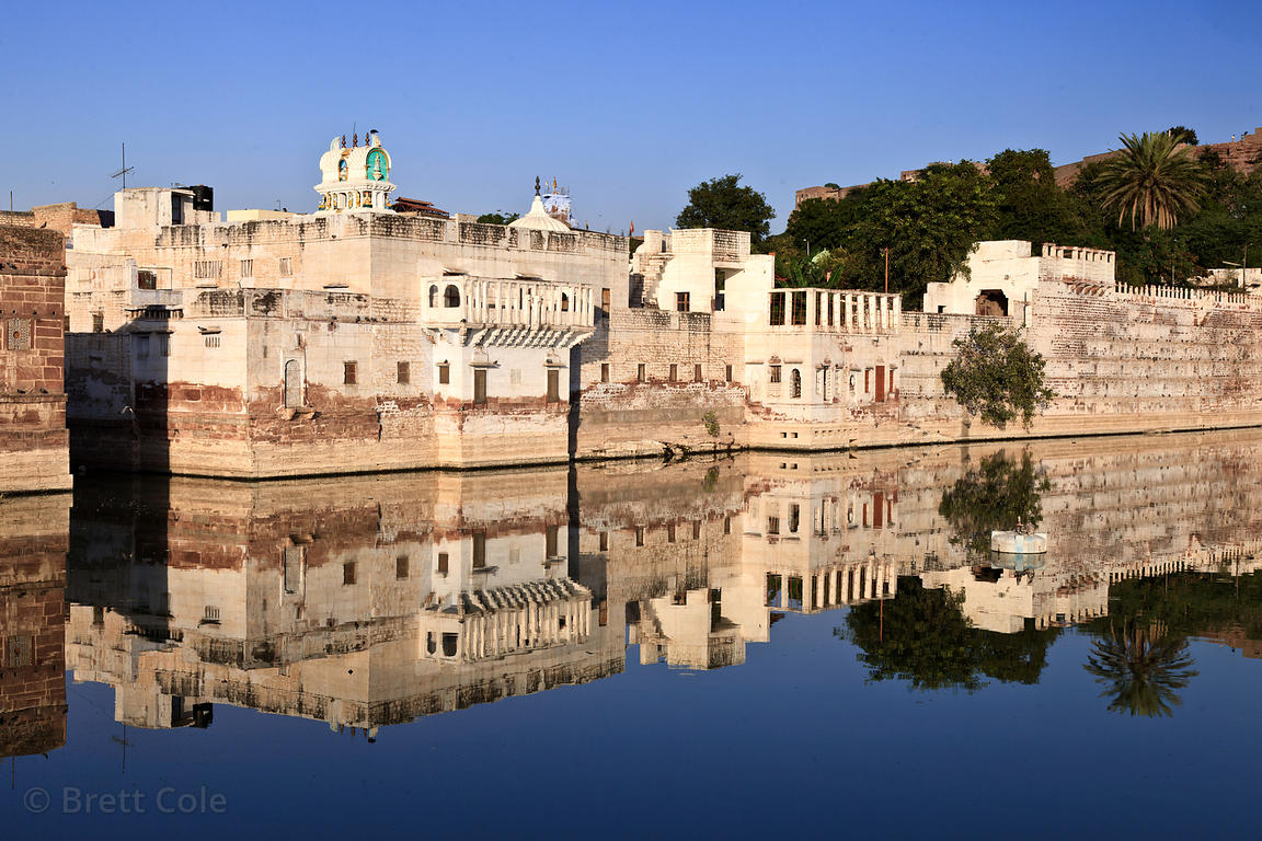 Temples reflect in the calm waters of Gulab Sagar, Jodhpur, Rajasthan, India