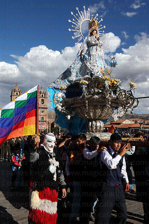 Virgin of the Immaculate Conception and Kapac Qolla dancer during parades for Corpus Christi festival , Cusco , Peru