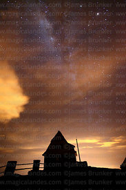 Milky Way and cloud above old ski hut on Mt Chacaltaya at night, Bolivia
