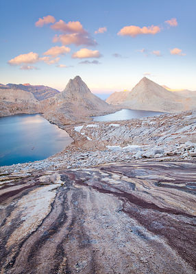 The granite mountains of the high sierra, with clouds at sunset. Royce Lakes seen from Feather Peak, John Muir Wilderness, Si...