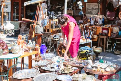 Woman in a flea market in the center of Athens, Greece