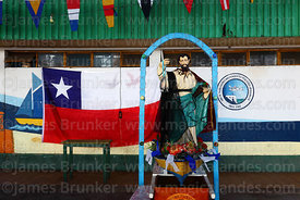 Statue of St Peter and national flag at St Paul festival, Arica, Chile