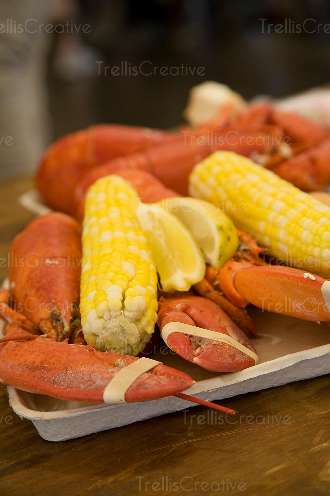 Steamed lobster with corn on the cob and melted butter at Rockland, Maine Lobster Festival