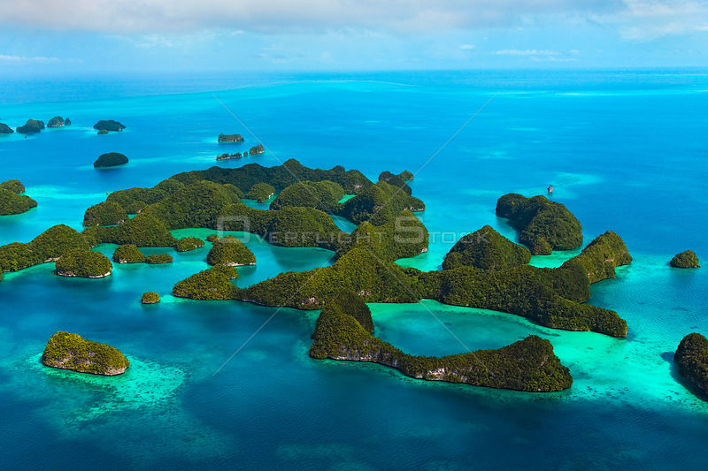 Aerial view of the Rock Islands covered with rainforest in Palau, Micronesia. The limestone islands have been eroded into mus...