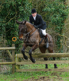 Geoff Bridges jumping a hunt jump near Knossington Spinney
