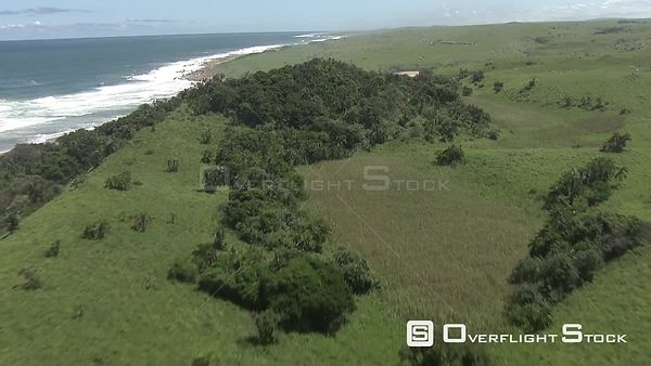 Aerial shot of waves hitting the rocks on the shore KwaZulu Natal South Africa