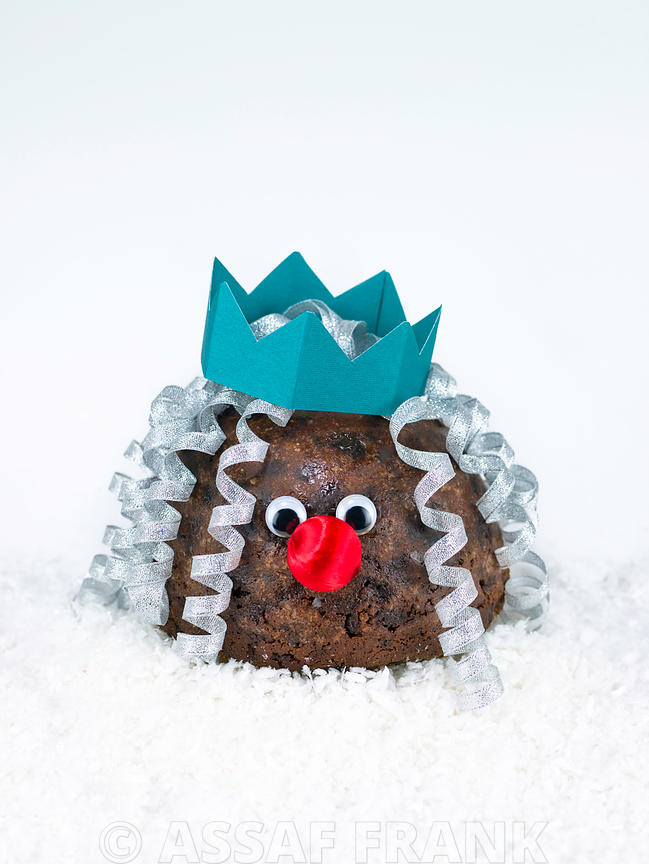 Christmas pudding with a face and a hat