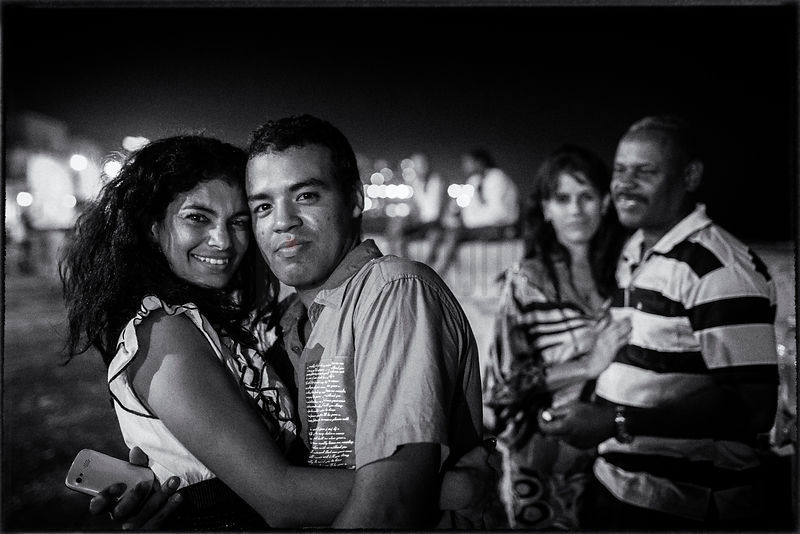 Couples on the malecon at Night