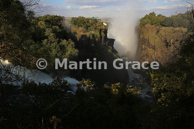Late afternoon view over Devil's Cataract (73m - foreground) at the western end of Victoria Falls to Cataract Island (left) a...