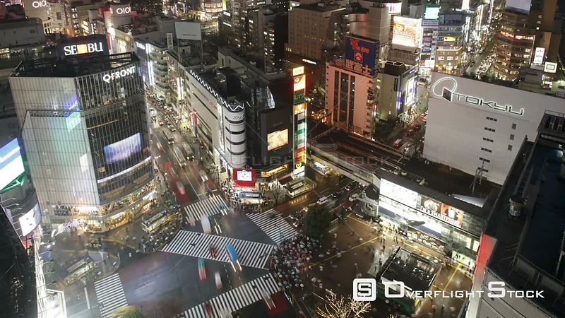 Wide timelapse shot of crowds of people crossing the centre of Shibuya shopping and entertainment district, Tokyo, Japan, 2011.