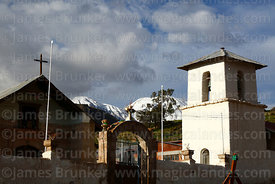 San Ildefonso church and main square, Nevados de Putre / Taapaca volcano in background, Putre, Region XV, Chile