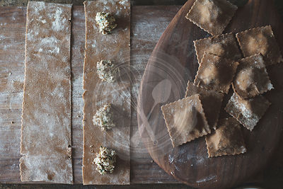 The cooking of chestnut flour ravioli with artichokes, peas and enoki mushrooms.