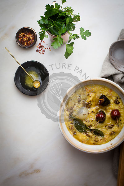 Indian lentil soup - dal fry on a marble table