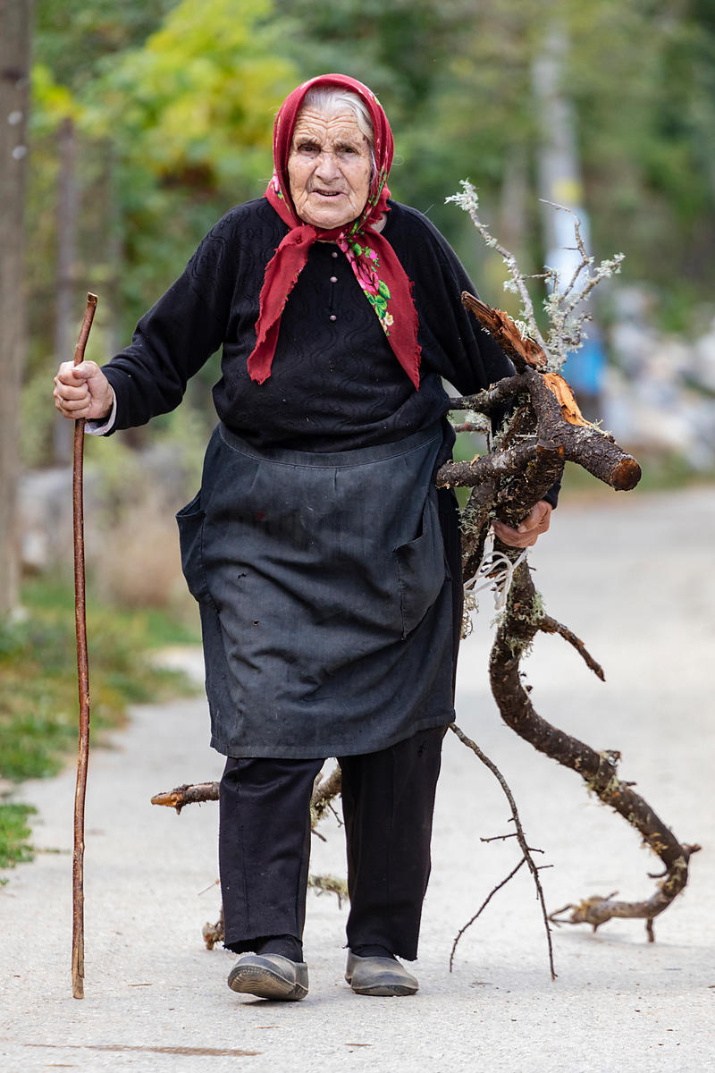 Portrait of Mjlica Carrying a Load of Firewood