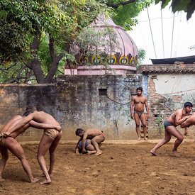 Khusti wrestlers practice at an akhara in New Delhi, India