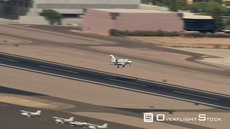 Aerial view of business jet taking off