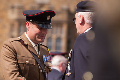 Garrison Sergeant Major WO1 greets a veteran