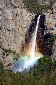 Sunlight creating a rainbow in the spray of the Bridalveil Falls, Yosemite National Park, California, USA, June 2008