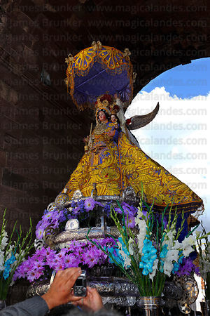 Man taking photo of Virgen de los Remedios with digital camera during Corpus Christi festival , Cusco , Peru