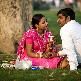 A couple hold hands in the park at India Gate. Public displays of affection are rare in a conservative city like Delhi. The p...