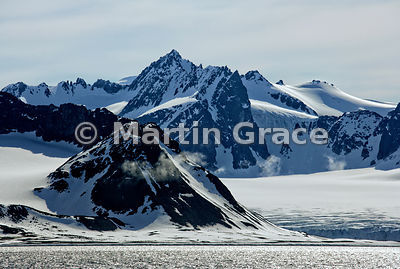 Spitsbergen landscape with snow, ice, sea and clouds, Albert I Land, Svalbard