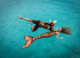 Faerie Laurie Smith flies down to Mermaid Rachel Smith during Mermaid Portfolio Workshop, Exuma Cays, Bahamas Islands
