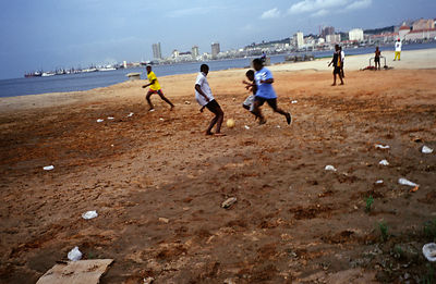 Angola - Luanda - children playing football on the beach, Luanda