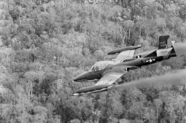 VIETNAM -- 1960s -- Cessna A-37A firing rockets while in flight in Vietnam. US Air Force photo (Released)