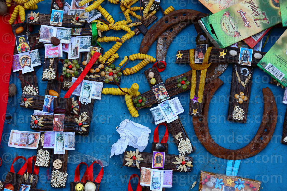 Miniature wooden crosses and horseshoe for sale in market for Alasitas festival, Puno, Peru