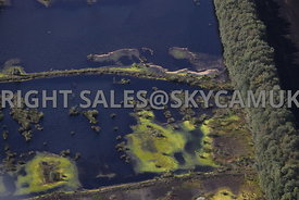 Chat Moss aerial photograph of Peat beds ponds created when the peat has been extracted leaving islands surrounded by bright ...