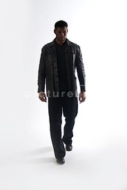 An image of a mystery man in a leather jacket, walking.