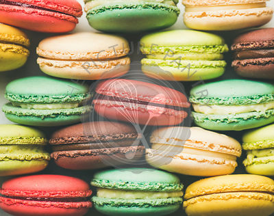Colorful French macaroons cookies in rows