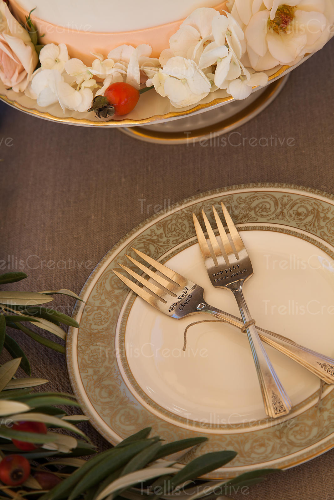 Wedding cake and sterling silver forks on plate
