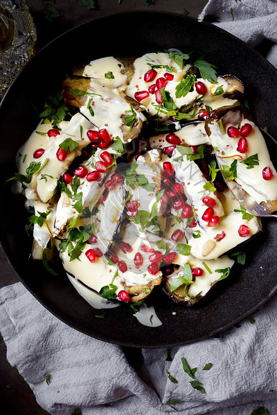 Eggplant in sauce, covered in pomegranate seeds