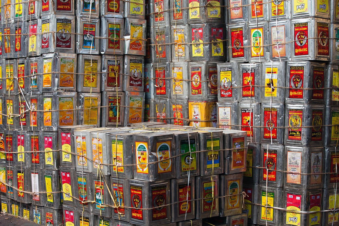 Tins containing oils and other food products are loaded on Strand Rd, a busy distribution center in Kokata, India.