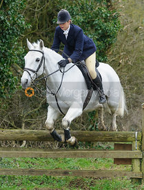 Lisa Freckingham jumping a hunt jump near Knossington Spinney