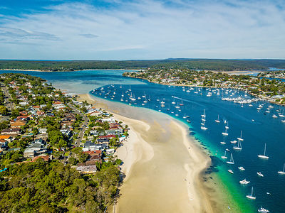 Aerial views of Gunnamatta beach and water views with the many luxury yachts Australia