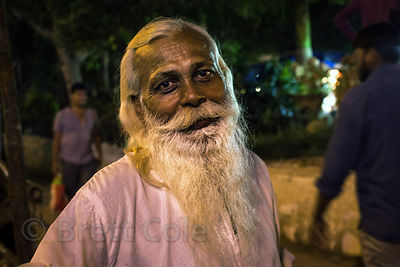 Portrait of an elderly man with a white beard on Chowpatty Beach, Mumbai, India.