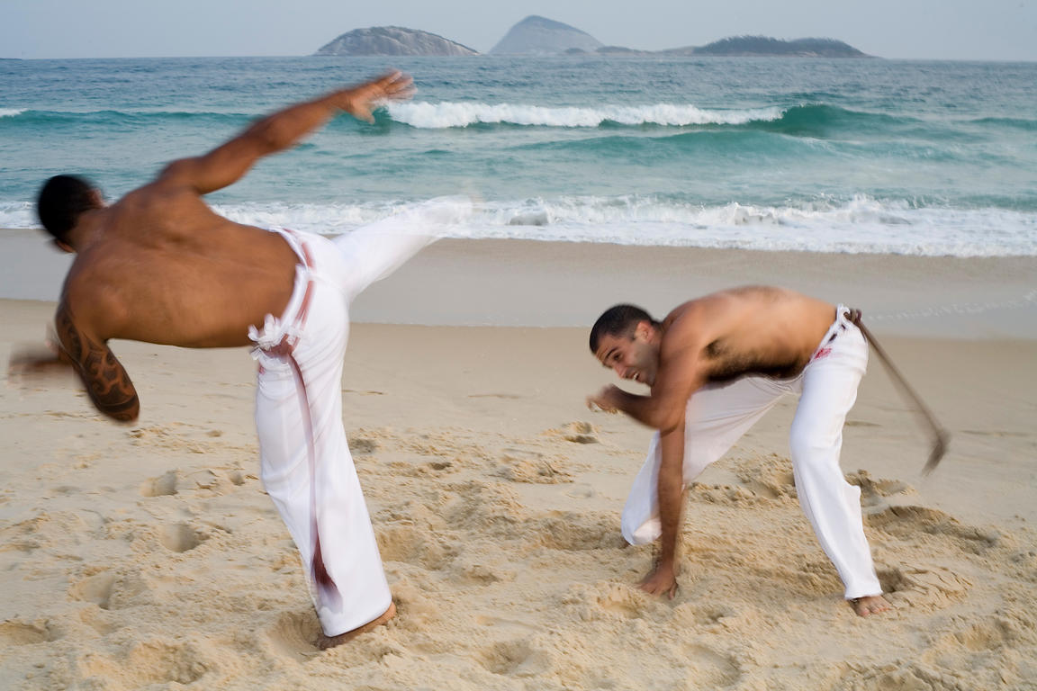 Capoeiristas practicing Capoeira