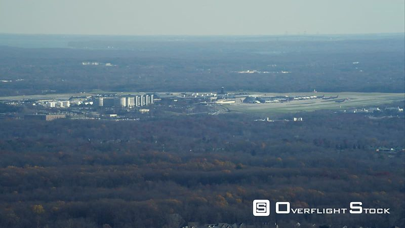 Flying over woodland past Baltimore Airport. Shot in November