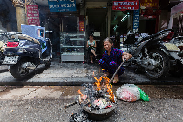 Woman Burning Gost Money in the Street