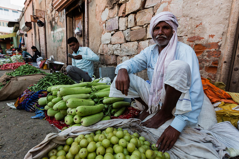 Man Selling Fruit at the Choti Chopad Wholesale Vegetable Market