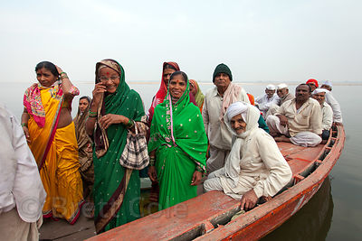 Hindu pilgrims exit a boat after a ride on the Ganges River, Varanasi, India.