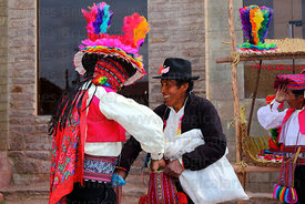 Men exchange coca leaves ( a traditional greeting ) at San Santiago festival, Taquile Island , Peru