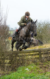 Roger Weatherby jumping the hunt jump at Newbold - The Fitzwilliam Hunt visit the Cottesmore at Burrough House