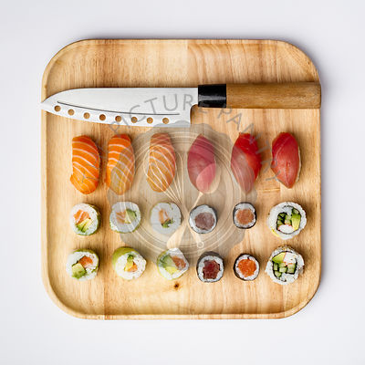 Japanese cuisine. Sushi set on a bamboo plate over white background