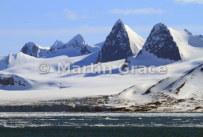 Stunning Hornsund landscape with crags, snowfields, glacier and sea ice, Spitsbergen, Svalbard